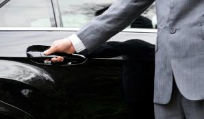 Man Holding Car Door Handle