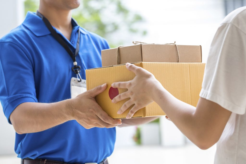 Person Handing Over Package
