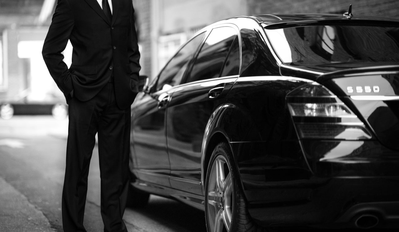 Man Standing With Car