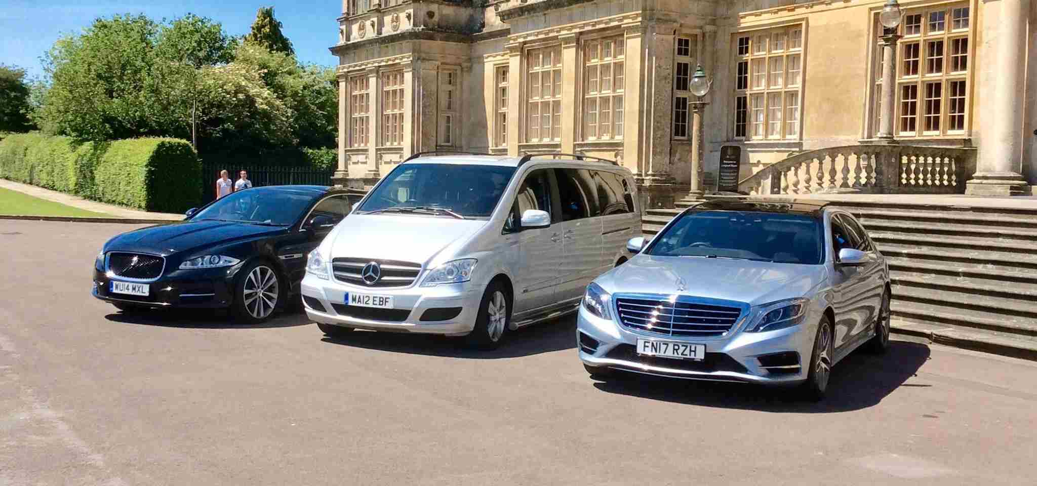 Executive Cars Parked Outside Building